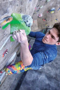 Colin Daniels, age 17, can handle an advanced workload, but young climbers are vulnerable to fractures in the growth plates of the fingers. Injury may occur or first present in stressful positions such as full crimping (as demonstrated). Instead favor the half (open) crimp in training and minimize use of the full crimp when climbing.