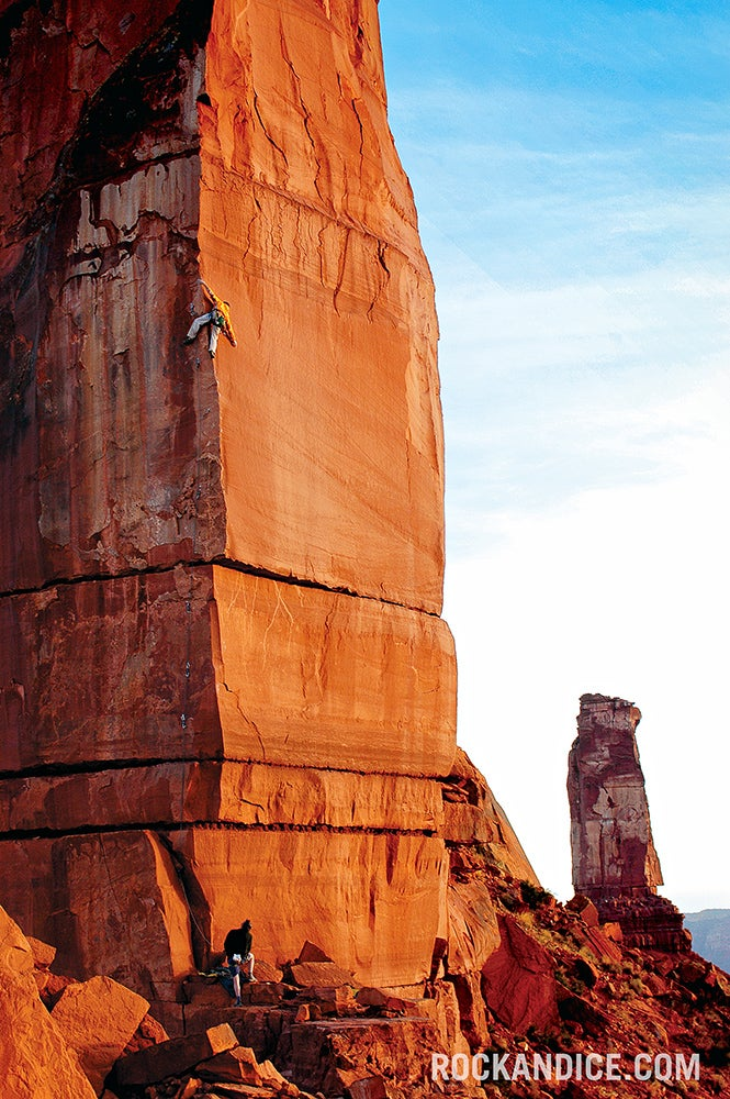 Tom Adams styles Excommunication (5.13b), one of a new generation of crackless tower routes, on the Priest, Castle Valley, Utah. Photo: Duane Raleigh.