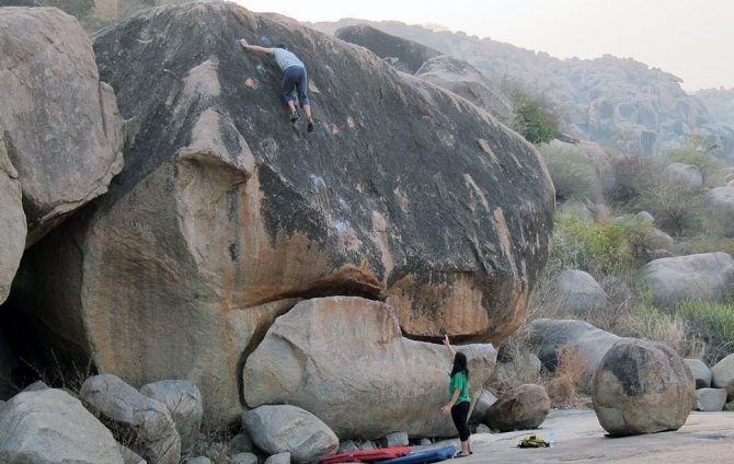What's the Point of Spotting Highball Boulder Problems?