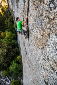 Honnold enjoying the fruits of his labor on A Gift from Wyoming (5.13b/c), a route inspired by Todd Skinner. Photo: John Dickey.