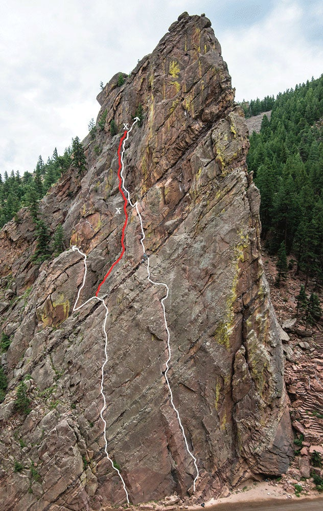Eldorado Canyon's famous Bastille, with Werk Supp (5.9) on the left and The Bastille Crack (5.7) to the right. The red line is the off-route path taken; the X's mark the beginning and end points of the fall. Photo: Celin Serbo.
