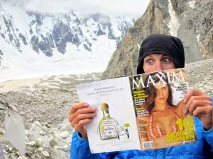 Kennedy catching up on some reading in basecamp. Photo: Kyle Dempster.