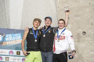 Photo of men's lead final podium, from left to right: Alexander Megos of Germany, second place; Jakob Schubert of Austria, first place; Dmitrii Fakirianov of Russia, third place. Photo: Eddie Fowke/IFSC.