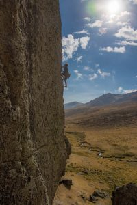 Fabian Freudig high above the crux on Chucru Rani (6a+/5.10c), an exposed 17-meter route bolted in 2006. Photo: Josh Laskin.
