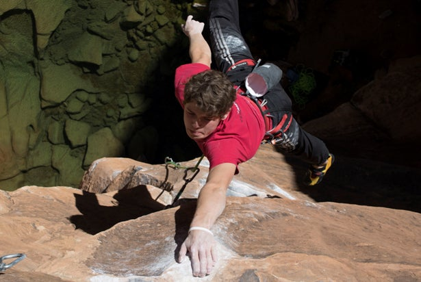 Harry Edwards strikes a Michael Jordan pose as he finally latches the crux dyno that took him months to conquer. Photo: Rob Edwards.