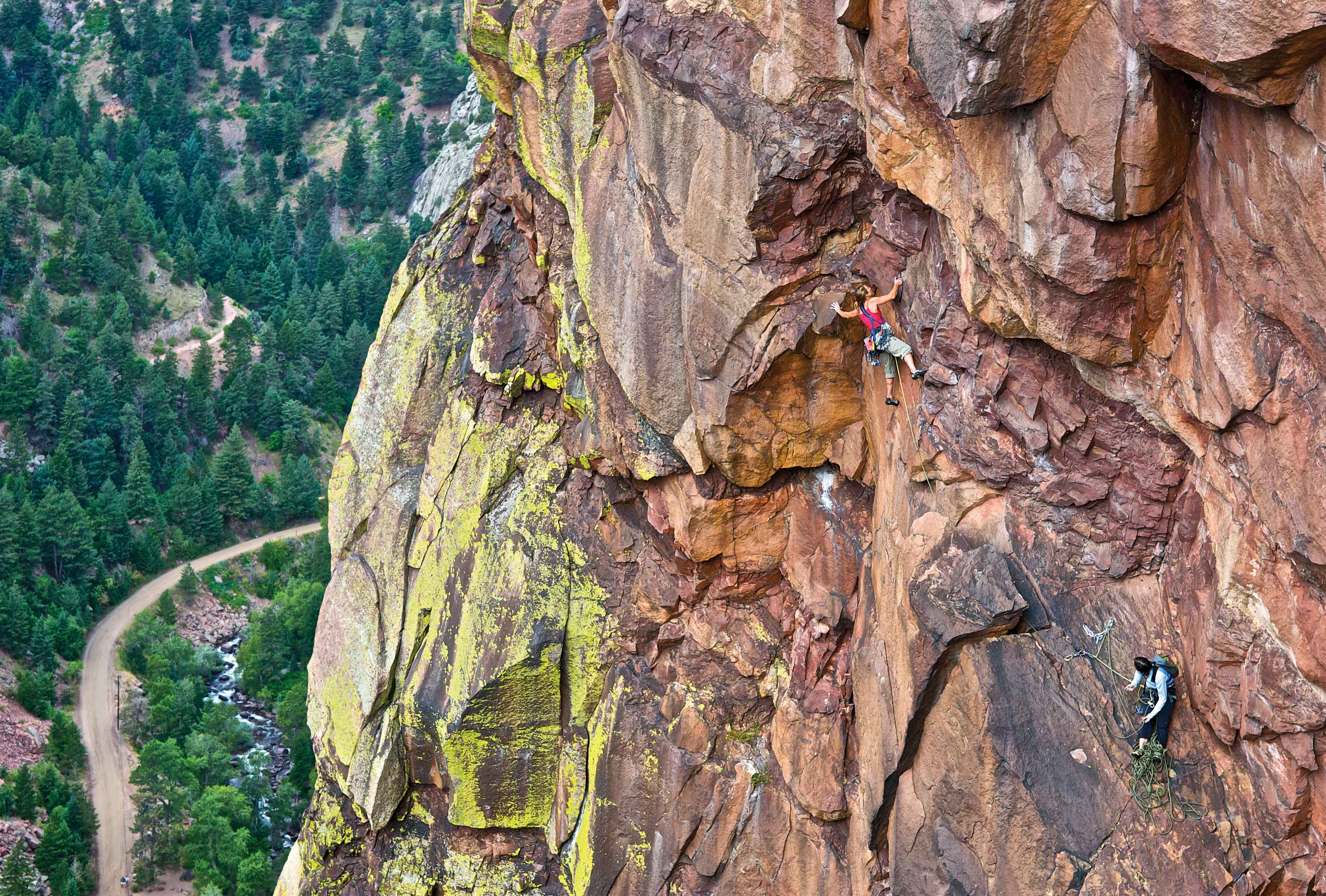Sheyna Button belays Heidi Wirtz as she gets into the business of The Diving Board (5.11b) in Eldorado Canyon. Photo: Celin Serbo.