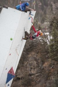 Nathan Kutcher celebrates his victory in the mixed climbing competition with a shot of tequila. Photo: John Evans.