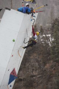 Angelika Rainer, the top-finishing woman and overall bronze medalist, stretches her way to the top. Photo: John Evans.