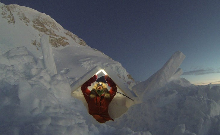 Dupre building a snow shelter at 14,200 feet on Denali in January 2015. Photo: Lonnie Dupre.