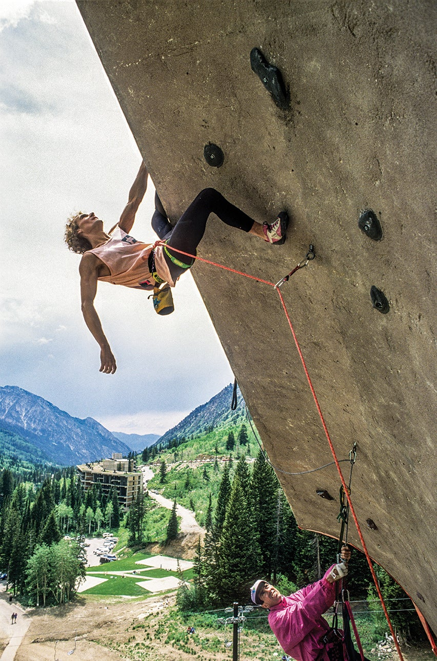 The French climber Patrick Edlinger's golden moment. Kim Carrigan, Australia's top climber, hangs below as a wall judge. Photo: Beth Wald.